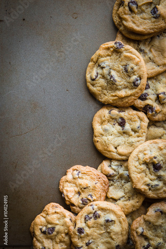 Tuinposter Koekjes batch of homemade chocolate cookies on baking sheet with copy space