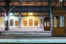 Passenger Platform At Night On The Railway Station. Train Station At Night.