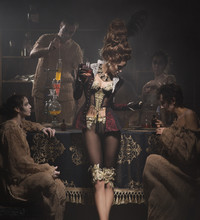 Woman In Beautiful Lingerie In An Old Laboratory With Laboratory Technicians Talking About Chemistry