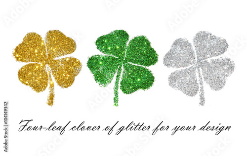 Set of abstract four-leaf clovers of green, golden and silver glitter for your design
