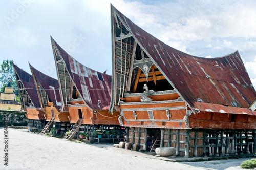 Photo Traditional Batak house on the Samosir island,  Indonesia