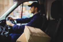 Delivery Driver Driving Van Wi...