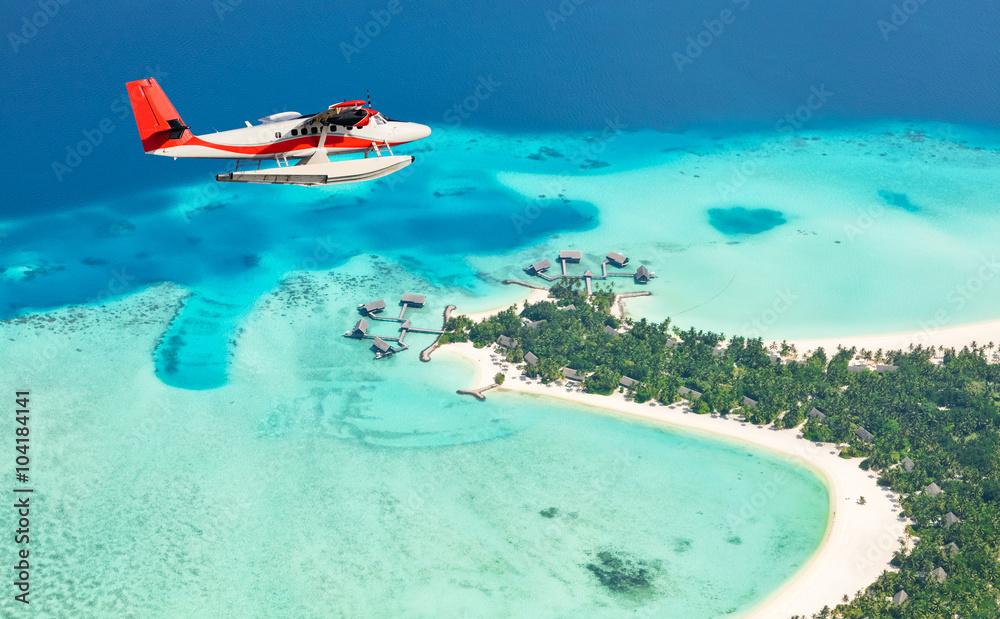 Fototapeta Sea plane flying above Maldives islands