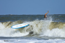 Man Wipeing Out On Surfboard