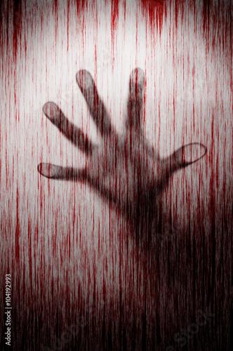 Blurry murderer hand behind matted glass with blood stain murder Canvas Print