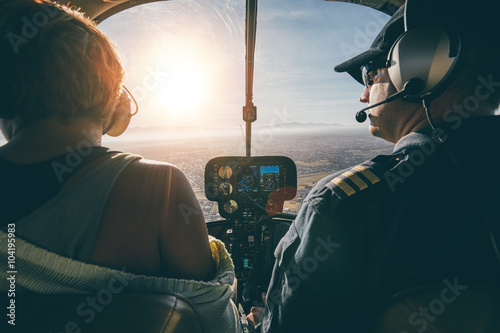 Vászonkép Man flying a helicopter with his copilot