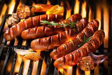 Sausages On The Barbecue Grill With Flames