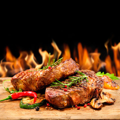 FototapetaGrilled beef steak with flames