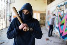 Unrecognizable Vandal With Wooden Baseball Bat