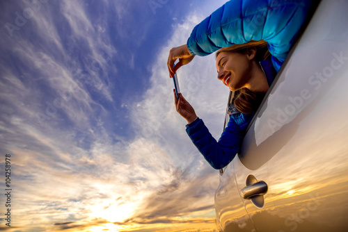 Young Woman Photographing With Smart Phone Beautiful Cloudscape
