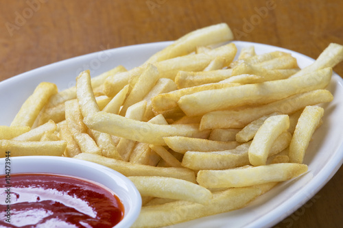 Photo  Delicious shoestring style french fries with ketchup