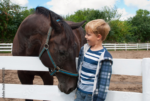 Boy with brown horse