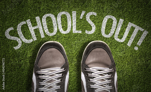 Top View of Sneakers on the grass with the text: Schools Out Fototapeta
