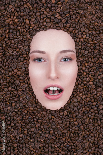 Photo Stands Coffee beans beautiful girl looks into the camera