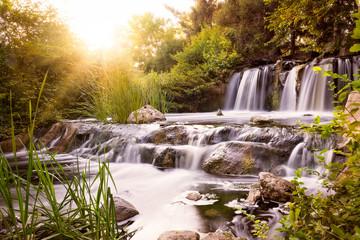 Panel Szklany Wodospad Rushing waterfall at sunset