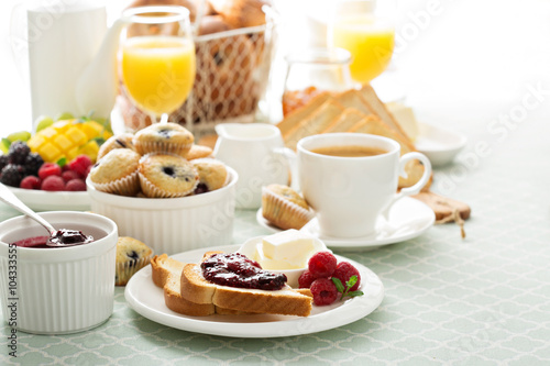 Fresh and bright continental breakfast table Wallpaper Mural