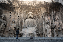 Buddha Sculpture On Cave Wall In Longmen Grottoes Longmen Caves