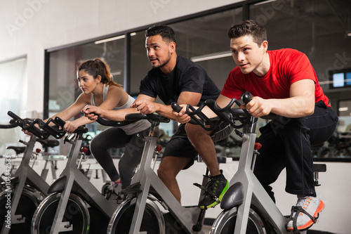People doing some spinning at a gym