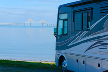RV Recreational Vehicle Is Parked At The Beach Overlooking Tampa Bay In Fllorida With The Skyway Bridge In The Background