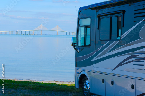 Fotografie, Obraz  RV recreational vehicle is parked at the beach overlooking Tampa Bay in Fllorida