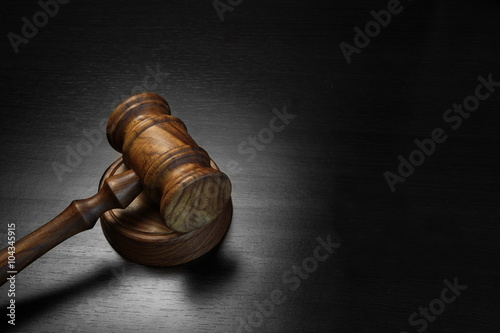Fotografering  Real Judges Or Auctioneer Gavel On The Black Wooden Table