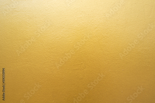 Fotografia  Gold concrete wall on background texture.