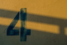 The Number 4 On The Wall Under The Shadow Of The Lights