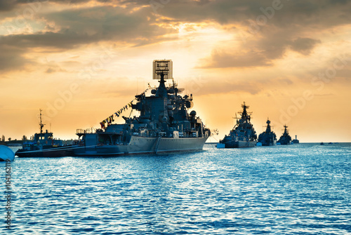 Fotografering  Military navy ships in a sea bay