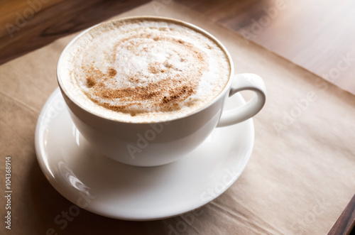 Fotografie, Obraz  Cappuccino. Cup of coffee stands on old paper