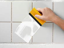 TILING AND GROUTING A WALL