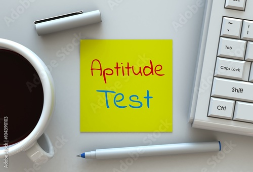 Aptitude Test, message on note paper, computer and coffee on table Canvas Print