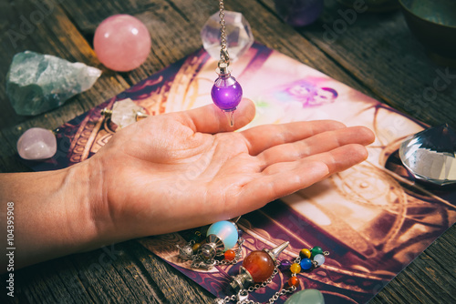 Photo Palm reading with pendulum