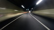 Driver POV hyperlapse through the newly built tunnel onto the highway and city lights.