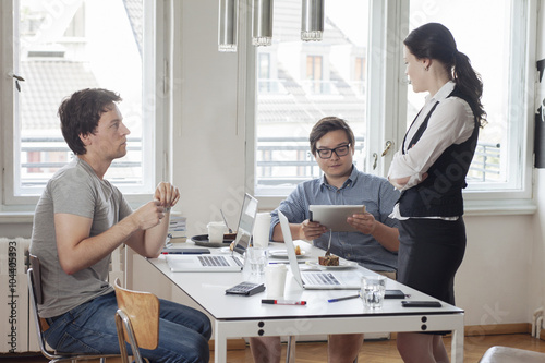 Staande foto Aziatische Plekken Three creative business people having a meeting in a modern office