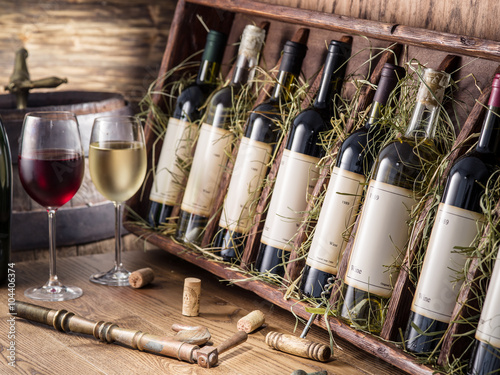 Wine bottles on the wooden shelf. - 104406374