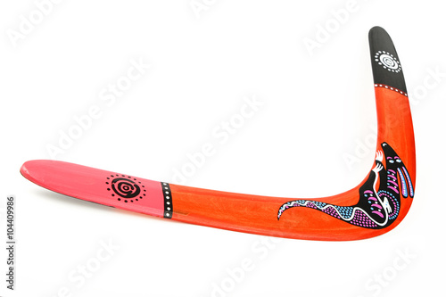Photo  One wooden painted colorful boomerang over white