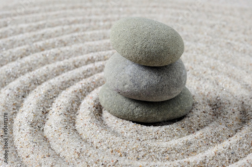 Tuinposter Stenen in het Zand Close up and selective focus of stacked zen stones