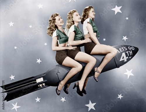 Fotografia, Obraz Three women sitting on a rocket