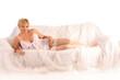 blonde girl on white sofa