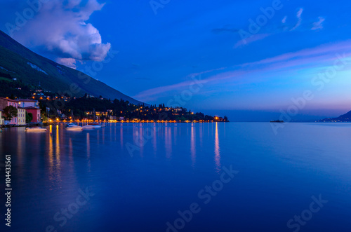 Fotobehang Noord Europa Tranquil sunset and evening illuminations of the beautiful town of Malcesine on Lake Garda in Italy.