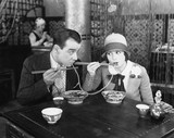 Couple sharing a noodle in a restaurant  - 104433746