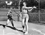 Two women playing baseball  - 104433984