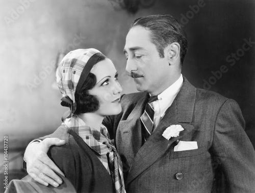 Fotografia, Obraz  Man with his arm around a woman
