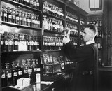 Man in a pharmacy mixing medicine  - 104441721