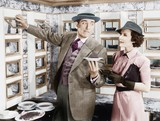 Man serving a dish to a woman in a Automat   - 104444534