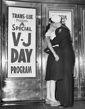 U.S. Sailor And His Girlfriend Celebrate News Of The End Of War With Japan In Front Of The TransLux Theatre In New York's Time Square, August 14, 1945