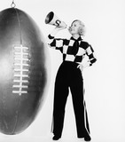 Woman with megaphone and huge football  - 104445519