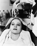 View of a female hairdresser washing hair of a young woman in a hair salon  - 104445717