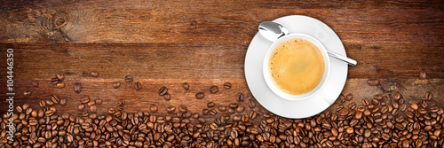coffee background with beans and cup on rustic old oak wood