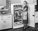 Woman with open refrigerator  - 104447512